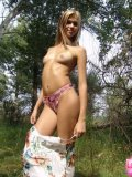 Brunette Teen With Raised Tits Fingering On Woods - Picture 8