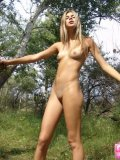 Brunette Teen With Raised Tits Fingering On Woods - Picture 12