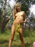 Brunette Teen With Raised Tits Fingering On Woods - Picture 14
