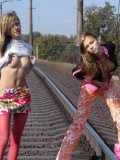Hot Teens Kissing And Flashing Boobies On The Rail - Picture 7